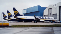 Passenger aircraft operated by Ryanair sit parked at London Luton Airport in Luton, England, on March 30, 2020. MUST CREDIT: Bloomberg photo by Chris Ratcliffe.
