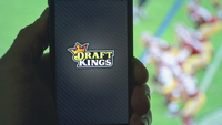 The DraftKings Inc. logo in an arranged photograph. MUST CREDIT: Bloomberg photo by Andrew Harrer.