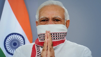 PM Modi was seen covering his mouth and nose with a 'gamcha'. (Photo: Twitter/@narendramodi)