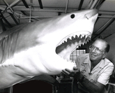Jack Randall is pictured in 1991 with a model of a white shark at the Taronga Zoo in Sydney. MUST CREDIT: Photo courtesy of the Randall family
