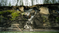 Permafrost at the top of a cliff melts into the Kolyma River outside of Zyryanka, Russia, in July 2019. This photo and accompanying story were part of The Washington Post's Pulitzer Prize-winning collection of stories about environmental devastation. MUST CREDIT: Washington Post photo by Michael Robinson Chavez