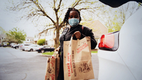 Ilanne Dubois, a 36-year-old single mother who was laid off in mid-March, completes her grocery shopping in New York. MUST CREDIT: photo for The Washington Post by Michael Noble, Jr.