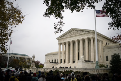 A crowd gathers outside the Supreme Court in Washington on Nov. 12, 2019. MUST CREDIT: Bloomberg photo by Al Drago.
