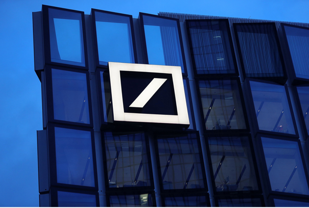 The Deutsche Bank logo sits on the bank's campus office building in Frankfurt., Germany. MUSTS CREDIT: Bloomberg photo by Krisztian Bocsi.