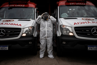 Alessandra Said dresses in protective clothing on May 2, 2020, in Manaus to attend a covid-19 case. MUST CREDIT: Photo for The Washington Post by Raphael Alves Photo by: Raphael Alves — The Washington Post Location: Manaus Brazil