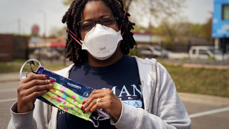 Schoolteacher DeAndra Knighten holds the face masks she got for her herself, her daughter and her husband at a May 9, 2020, event in Minneapolis where activists distributed masks intended to help protect the African American community from covid-19. MUST CREDIT: Photo for The Washington Post by Jared Goyette