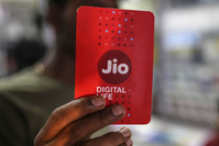 A sim card packet for Reliance Jio, the mobile network of Reliance Industries Ltd., in Mumbai, India, on Jan. 19, 2020. MUST CREDIT: Bloomberg photo by Dhiraj Singh.