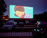 Movie-goers watch an animated short before the feature film at Ocala Drive-In Theater in Florida. MUST CREDIT: Zack Wittman/Bloomberg