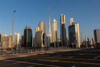 An empty highway leads past the Burj Khalifa skyscraper (center) and other office buildings on the city skyline during the coronavirus lockdown in Dubai, United Arab Emirates, on April 24, 2020. MUST CREDIT: Bloomberg photo by Christopher Pike.