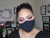 Melina Basnight, who makes makeup tutorials for her YouTube channel Makeup Menaree, shows off a bold eyeshadow look to go with her face mask. MUST CREDIT: Melina Basnight