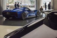 A visitor takes a photograph of a NIO EP9 autonomous electric vehicle (EV) on display at the company's NIO House brand experience center in Beijing on Dec. 2, 2017. MUST CREDIT: Bloomberg photo by Gilles Sabrie.