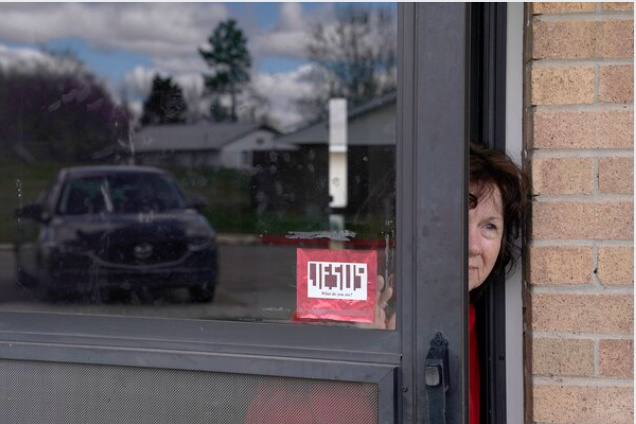 Patricia Flood, who has COPD and other health issues, peeks out of her front door in Bristow, Okla. MUST CREDIT: Photo for The Washington Post by Nick Oxford