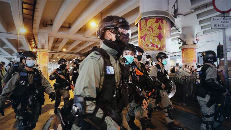 Riot police charge at demonstrators during a protest against a planned national security law in the Wan Chai district of Hong Kong on Sunday, May 24, 2020. MUST CREDIT: Bloomberg photo by May James