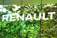 Trees are reflected on the glass facade of the Renault SA flagship showroom on the Champs Elysee in Paris, France, on Wednesday, May 27, 2020. MUST CREDIT: Bloomberg photo by Adrienne Surprenant