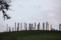 A refinery stands next to Charles H. Milby Park in Houston on March 8, 2020. MUST CREDIT: Bloomberg photo by Sharon Steinmann.