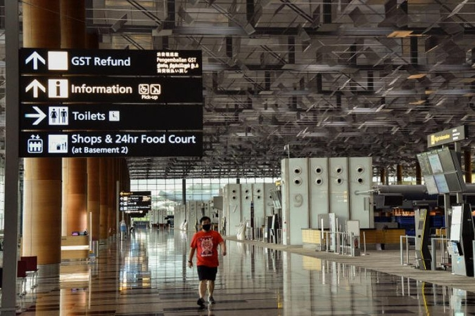 Protocols for essential travel would include testing travellers leaving and entering Singapore. ST PHOTO: DESMOND WEE