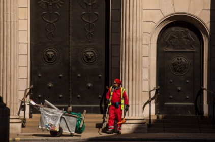 A municipal worker cleans the street outside the Bank of England in the City of London. MUST CREDIT: Bloomberg photo by Simon Dawson