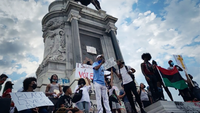 Demonstrators protest Wednesday in front of the statue of Confederate Gen. Robert E. Lee on Monument Avenue in Richmond, Va. Unveiled in 1890, it had become for many a symbol of racism. MUST CREDIT: Washington Post photo by Laura Vozzella