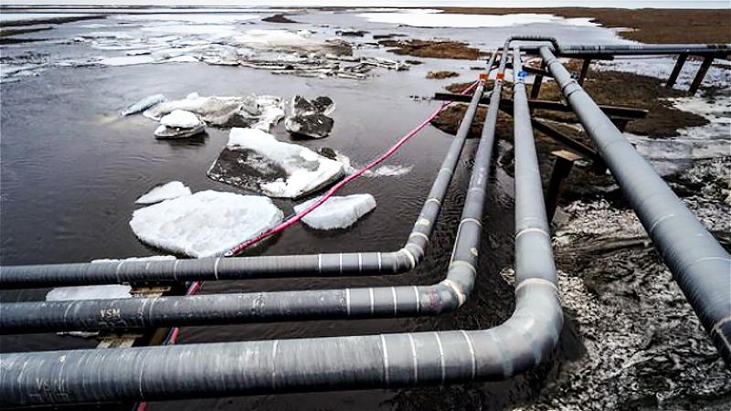 Pipelines extend across the landscape outside Nuiqsut, Alaska, in 2019. MUST CREDIT: Washington Post photo by Bonnie Jo Mount