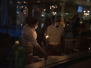 Waiters deliver food to a table at a restaurant after coronavirus disease restrictions were lifted in Houston on May 27., 2020. MUST CREDIT: Bloomberg photo by Callaghan O'Hare.