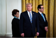 President Trump, Small Business Administration Administrator Jovita Carranza and Treasury Secretary Steven Mnuchin speak about the Paycheck Protection Program at the White House on April 28. MUST CREDIT: Washington Post photo by Jabin Botsford.
