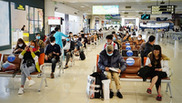 Passengers waiting for flights at Nội Bài International Airport. Việt Nam is considering reopening commercial flights from