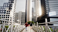 Pedestrians cross a footbridge on May 20 in the Sudirman Business District of Central Jakarta. The capital city has gradually started reopening economic activities in June while continuing to enforce social distancing and health protocols. JP/Dhoni Setiawan (JP/Dhoni Setiawan)