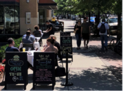 Diners take advantage of a mild summer day and the further opening of business on Friday in Arlington as Northern Virginia moved into Phase 2 of coronavirus recovery. MUST CREDIT: Washington Post photo by Jahi Chikwendiu.