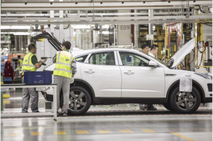 Employees assemble a Jaguar E-Pace compact sport utility vehicle on the production line at the second phase of the Chery Jaguar Land Rover Automotive Co. plant in Changshu, China, on June 27, 2018. MUST CREDIT: Bloomberg photo by Qilai Shen.