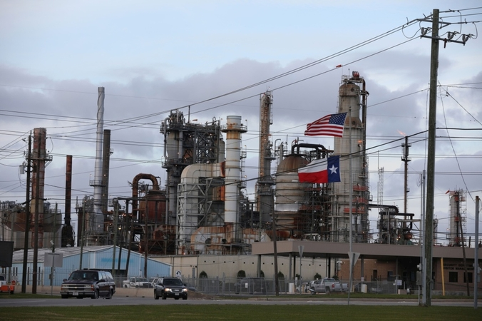 An American and Texas flag fly in front of a Chevron refinery in Pasadena, Texas, on March 8, 2020. MUST CREDIT: Bloomberg photo by Sharon Steinmann Location: Houston, United States