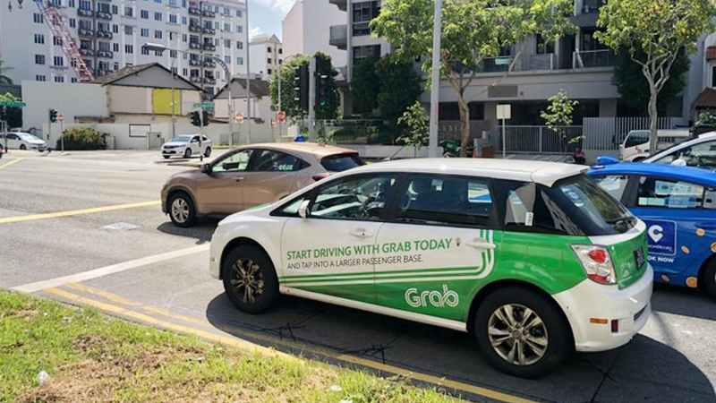 Demand for ride-hailing services, which is Grab's main business, has fallen amid the pandemic. ST PHOTO: DESMOND WEE