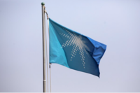 A flag bearing the Saudi Aramco oil company logo flies at the company's compound in Dhahran, Saudi Arabia, on Oct. 3, 2018. MUST CREDIT: Bloomberg photo by Simon Dawson.