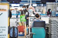 Passengers at Kuala Lumpur International Airport (KLIA). PHOTO: BERNAMA