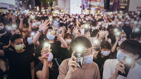 Demonstrators wearing protective masks shine lights from their smartphones during a protest in the Causeway Bay district of Hong Kong on June 12, 2020. MUST CREDIT: Bloomberg photo by Justin Chin. Location: Hong Kong, Hong Kong