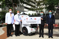"Takorn Tantasith, third left, secretary-general of the National Broadcasting and Telecommunications Commission, together with Abel Deng, fourth left, CEO of Huawei Technologies (Thailand), hand over a 5G unmanned vehicle to Siriraj Hospital under the ""Unmanned Vehicle Pilot Project Driving Thai Healthcare to 5G Era"" project. Receiving the donation on behalf of the hospital are Prof Dr Prasit Watanapa, second left, Dean of Faculty of Medicine, and Assoc Prof Visit Vamvanij, first left, hospital director of Siriraj Hospital."