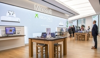 Surface laptops sit on display ina Microsoft store in central in London in 2019. MUST CREDIT: Bloomberg photo by Chris J. Ratcliffe