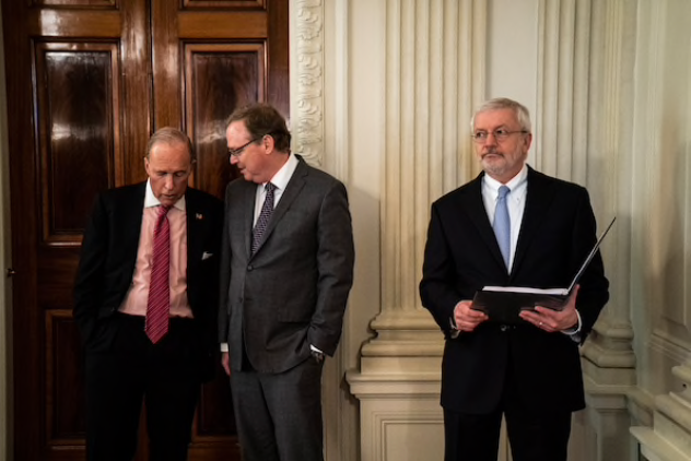 White House economic advisers Larry Kudlow, left, and Kevin Hassett speak before President Trump's roundtable with industry executives at the White House in late April. Josh Bolten, president and CEO of the Business Roundtable, is on the far right. Hassett is one of several economic aides to signal their departures over the past month. MUST CREDIT: Washington Post photo by Jabin Botsford.