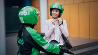 Speedy service: Grab Indonesia's GrabBike drivers pick up passengers, packages and food ordered via its mobile phone app.