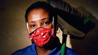 Sabrina Hopps works in housekeeping at a hospital in Washington, D.C. When her supervisor announced the room number of the first case of coronavirus at their medical facility, Hopps instantly recognized it as one she had scrubbed earlier in the day. MUST CREDIT: Washington Post photo by Jahi Chikwendiu