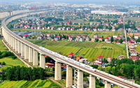 A trial train hits 220 kilometers per hour on a section of the Shanghai-Suzhou-Nantong Railway during a top-speed test run on May 4. [XU CONGJUN/FOR CHINA DAILY]