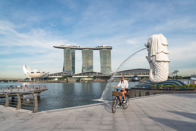 A cyclist passes the Merlion Statue in a near-empty Merlion Park during the lockdown in Singapore on May 20, 2020. MUST CREDIT: Bloomberg photo by Lauryn Ishak