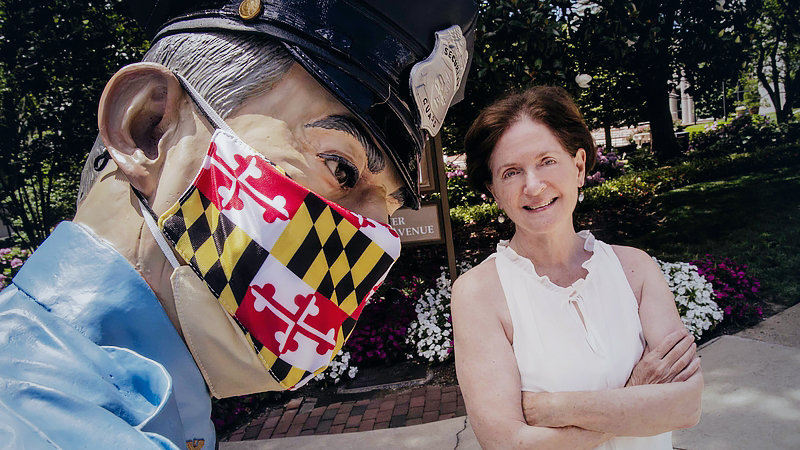 Dana Faulkner, who is concerned about her mother's approach to social distancing, poses with a masked statue in Chevy Chase, Md., on June 24, 2020. MUST CREDIT: Washington Post photo by Bill O'Leary