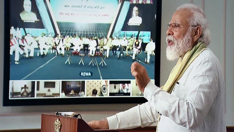 Prime Minister Narendra Modi dedicates to the nation a 750-megawatt ultra mega solar power plant set up at Rewa in Madhya Pradesh through video conference from Delhi. (Photo: Twitter | @BJP4India)