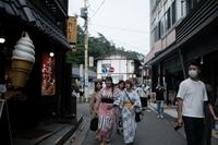 People wearing yukata robes walk past stores in Kusatsu, Japan, on June 27, 2020. MUST CREDIT: Bloomberg photo by Soichiro Koriyama.  Location: Kusatsu, Japan