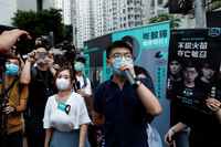 Pro-democracy activists Tiffany Yuen Ka-wai (left) and Joshua Wong attend a campaigning during primary elections, in Hong Kong, on July 11, 2020.PHOTO: REUTERS