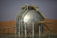 A storage tank containing liquid gas stands at the Natural Gas Liquids (NGL) facility in Saudi Aramco's Shaybah oil field in the Rub' Al-Khali (Empty Quarter) desert in Shaybah, Saudi Arabia. Photographer: Simon Dawson/Bloomberg