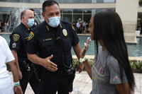 Art Acevedo, police chief in Houston and president of the Major Cities Chiefs Association greets people standing in line at George Floyd's funeral. (Joe Raedle/Getty Images)