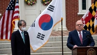 Hogan was joined by South Korea's director of public diplomacy to announce the purchase. MUST CREDIT: Washington Post photo by Michael Robinson Chavez