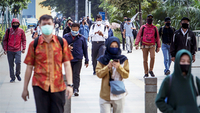 People walk near the Dukuh Atas railway station in Central Jakarta on May 12. (JP/Seto Wardhana)