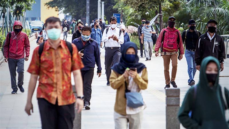 People walk near the Dukuh Atas railway station in Central Jakarta on May 12. (JP/Seto Wardhana)